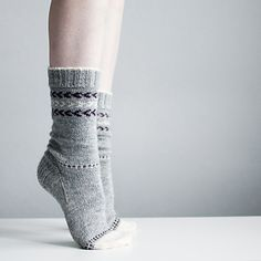 """""""Snowy Toes"""" are cozy basic socks in stockinette, worked from top down, with a gusset heel, colored toes, and some simple Fair-Isle details. Fun to knit and perfect for colorwork first-timers. The pattern comes in four sizes and includes schematics and charts to choose a size."""