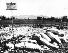 """Squash field at site of future CSUN campus, with """"State Property"""" sign visible. This is the campus site just after it was purchased by the state but before construction began on the San Fernando Valley campus of Los Angeles State College, circa 1955-1956. CSUN University Digital Archives."""