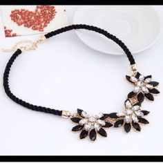 """Statement Flower Necklace Big and chunky necklace. Black rope chain is about 17"""" plus it has a 2"""" gold extender chain and lobster clasp. New in package. Zinc alloy, rhinestones, and resin. Jewelry Necklaces"""
