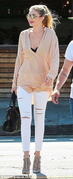 Simply stylish: Gigi rocked the quintessential off-duty model look, wearing a pair of whit...