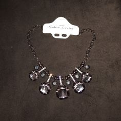 Cute necklace for work or a night out Cute necklace for work or a night out! Smokey gray color with a little tint of purple and black Jewelry Necklaces
