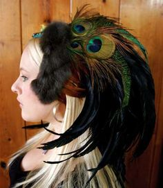 Peacock feather and more head dress. I love this