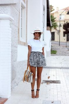 Trick to this look: Printed short with a high-quality t-shirt, neutral colors, classic heel, bag adds interest without distracting in bright color.  (I just love the back and hat and that the shoes have an ankle strap.)