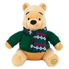 Disney Winnie the Pooh Plush - Holiday - Medium - 12'' | Disney StoreWinnie the Pooh Plush - Holiday - Medium - 12'' - ''Share the Magic'' all season long with our soft, fluff-stuffed Winnie the Pooh Plush, a tubby little cubby dressed in his cuddliest warmwear: a plaid knit scarf and matching knit sweater.