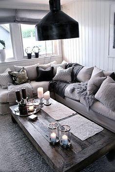 Cottage Living Room with Crown molding, Wainscotting, Global views twilight hurricane, Standard height, Carpet, Pendant light