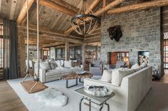 Freedom Lodge is a stunning family alpine home was designed to be enjoyed throughout the seasons by Pearson Design Group in Big Sky, Montana.