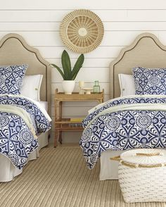 blue and white bedding with sisal rug. coastal inspired bedroom