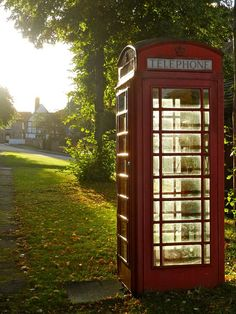Charming England...I will pin these lovely red phone booths as often as I can...love them!  ♥