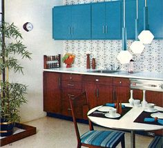 1965 Kitchen. I like how the cabinets have different colors. One wood toned on bottom and  the bold color above.  Very easy to replicate on any budget.
