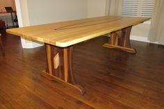Picture of Trestle table with floating arched stretcher
