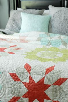 I love how the gray and aqua pillows modernize the look of the quilt