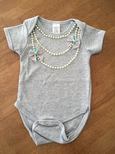 Pearl necklace onesie