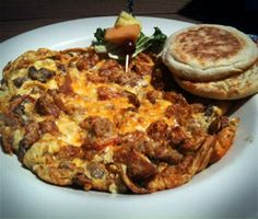 Hopple-Popple Open-faced omelette loaded with with sausage, bacon, peppers, onions, and mushrooms, with cheddar jack cheese