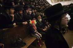 A child dressed in a clown costume at a synagogue in Jerusalem on March 8, 2012.