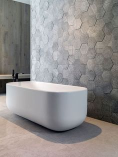 Объемная стена Bathroom Tile Ideas - Grey Hexagon Tiles // These grey hexagonal wall tiles stick out slightly from the wall to create a textured honeycomb look.