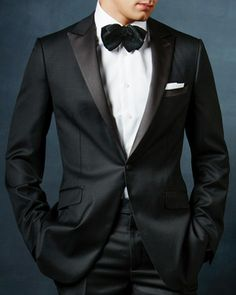 Paul Betenly Tuxedos. Available in stock or to order with peak or notch lapel.
