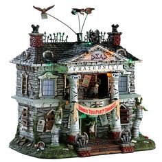 Lemax Dead Fraternity.  SKU# 75171. Released in 2017 as a Sights and Sound piece for the Lemax Spooky Town Village Collection.