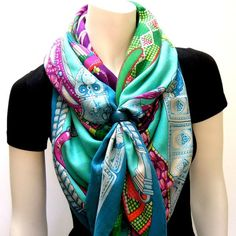 Fold your scarf into a triangle then fold the long edge over, about 5 inches wide gather the ends together and bring behind your neck cross the ends.. pull tigh