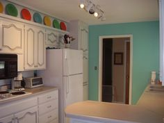 My kitchen newly painted in Sherwin-Williams Holiday Turquoise. -TL