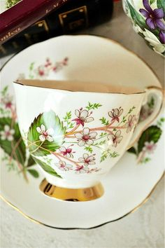 **Royal Stafford 'London Pride' Floral Teacup and Saucer Bone China England** A beautiful array of pink and grey flowers gives this piece a charming feel. Lovely for any tea party, and also makes a wonderful gift! :) This Royal Stafford teacup and saucer is in good vintage condition with