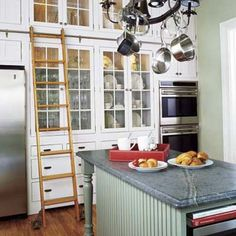 Keep the space in high-up kitchen cabinets from going to waste with this DIY rolling library-style ladder. | Photo: Beth Singer | thisoldhouse.com