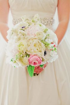 Yummy, lush and gorgeous! I want to eat that big fluffy peony and ranunc!