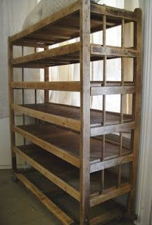 vintage factory shoe racks. New workshop ideas, perfect storage for pottery! Just needs some paint for easy cleaning!