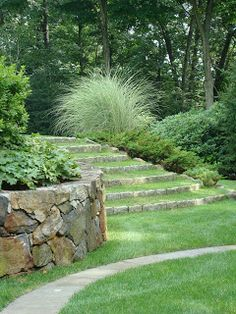 Interesting way to use pavers, maintain the grass, yet have 'stairs' down a slope near the garden.