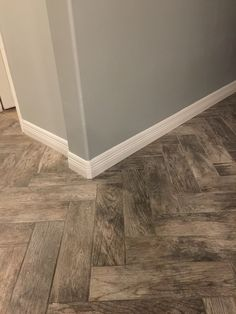 Tile plank floor from Home Depot-rustic bay. Looks great with Herringbone layout and Sherwin Williams Grey Matters.