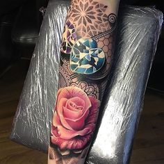 Amazing artist Ryan Smith @ryansmithtattooist color pink realistic rose with heart jewels forearm ...
