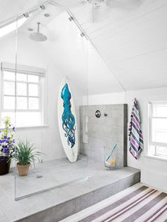 Love this glass shower enclosure (and the surfboard)!