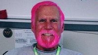Teacher David Robinson dyed his hair and beard bright pink when he lost a bet with students.