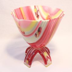 """Fused glass on-foot drop-out vessel. Pink, Yellow, white and french vanilla. 8"""" Diameter"""