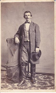 A Civil War era portait of a man wearing riding boots and holding a broad brimmed hat, taken by Fischer & Bro. of Baltimore, Maryland, ca 1862