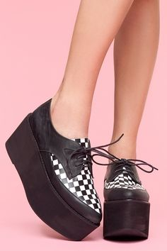 Checkerboard platform oxfords. Would be so cute with black shorts and a bright color top