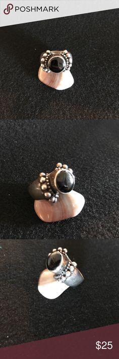 Black onyx and sterling silver ring Vintage sterling silver and black onyx ring 💍                                   Signed: it has marking on it but they are worn down...... if you don't like my price make me a offer! Jewelry Rings