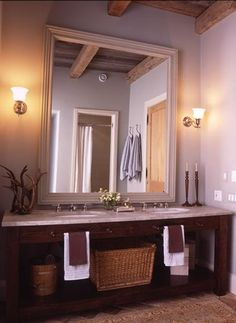 a vanity with no cabinets or drawers would make the small bath feel bigger and keep space clean...     Also two lights on either side of the mirror would be nice to replace the one light above the mirror
