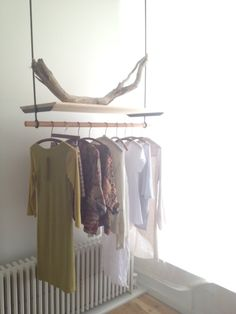 hanging clothing racks by John Cocoran @ KOSA