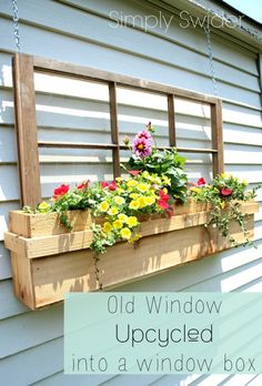 A great idea for old windows! Hang them with window boxes. This would be a great way of filling up a blank exterior wall.