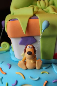 Dog holding a balloon by Andrea's SweetCakes, via Flickr