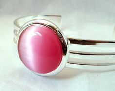 I actually love this one best! Pink Cats Eye Cuff Bracelet by ElunaJewelry on Etsy, $35.00