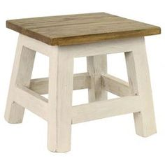 "Add a country-chic touch to your living room or master bath with this handcrafted mahogany wood stool, showcasing a distressed finish for rustic appeal.  Product: StoolConstruction Material: Mahogany woodColor: White and naturalFeatures: HandcraftedDimensions: 10.24"" H x 10.24"" W x 10.24"" D"