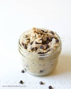 A small mason jar filled with gluten-free edible chocolate chip cookie dough