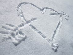 """buy the fake snow """"stuff"""" for windows and when people walk in the first thing they will see is a heart with Sarah -n- Tom on the door.....cheesy?  maybe...maybe not!"""