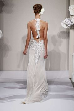 This sheath gown features a v-neck neckline with a dropped waist in silk chiffon and beaded embroidery. It has a chapel train and a tank top.  Pnina Tornai for Kleinfeld Bridal - October 2013