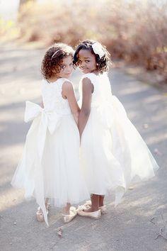 precious flower girls & gorgeous dresses!  love the big bows :)