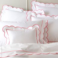 """Cool, crisp 500 thread count Egyptian cotton percale bed linens in white, Butterfield by Matouk, is embellished with an extra-large scallop and satin stitch. Fitted sheet is solid white. Duvet covers have a 3"""" flange. Pairs beautifully with Lanai. Made in the U.S.A. of Italian fabric."""