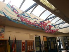 """Dev. Ed., Kindergarten, Grades 1-3 students worked on this sea of pink fish.  It was ready for our anti-bullying week ending with a concert by Hoja.  On April 11th our students were a """"school"""" of pink themselves in pink shirts."""