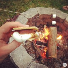S'mores made with Peanut Butter Cups - yes please! #camping