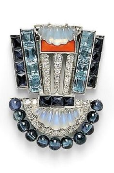 Art Deco Platinum Gem-set Clip Brooch, of geometric form, set with carved moonstones, channel-set French-cut sapphires and step-cut aquamarines, buff-top coral accent, and sapphire beads, further set with full- and single-cut diamonds, engraved gallery. #ArtDeco #clip #brooch